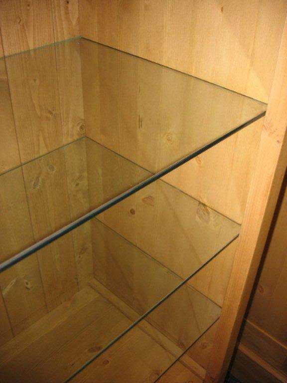 floating glass shelves in cupboard