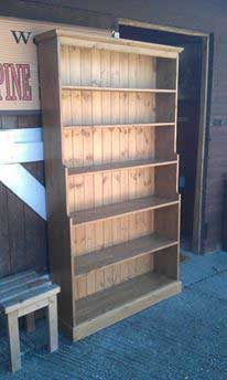 large stepped waxed pine bookcase